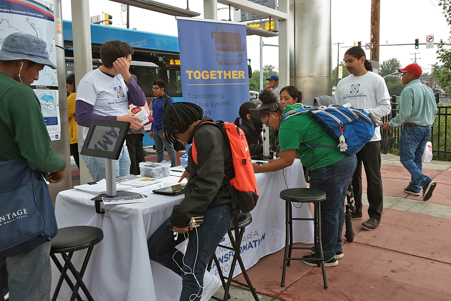 People at the Takoma Langley Crossroads Transit Center Event