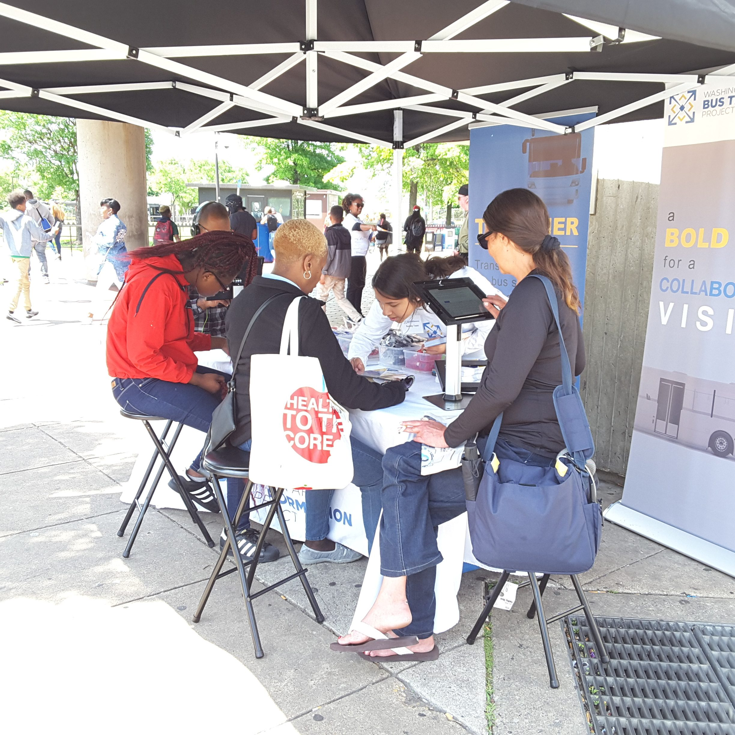 People gathered at the Anacostia Metro Station popup event booth