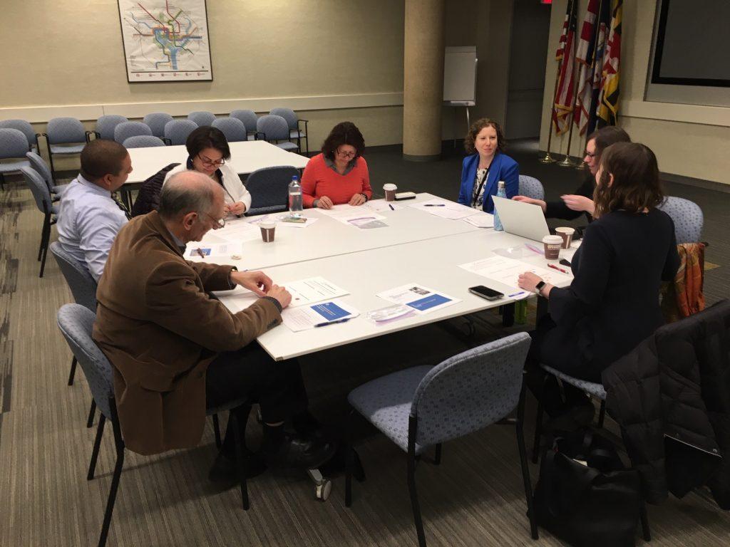 CBO focus group members sitting around table