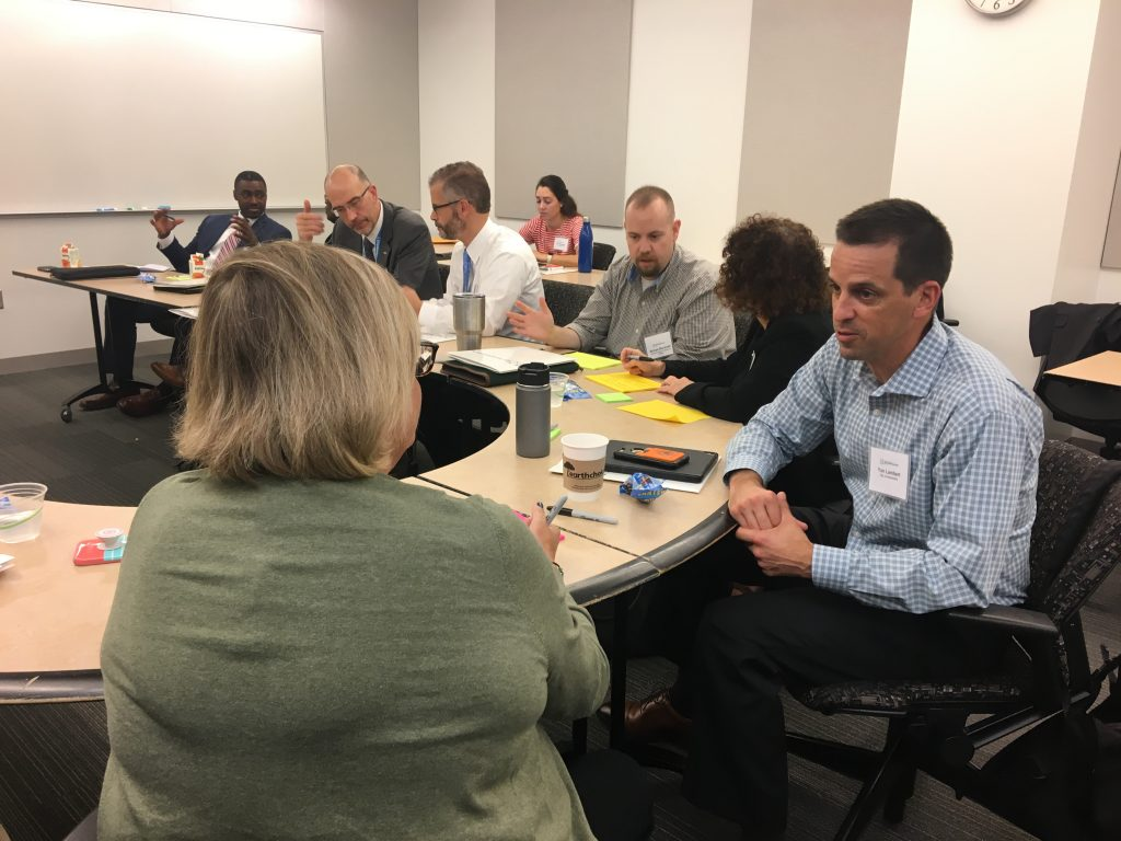 People have discussions at the kickoff summit
