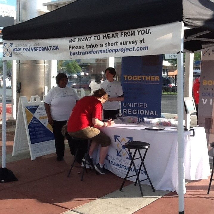 Event booth with people at Takoma Langley Crossroads Transit Center