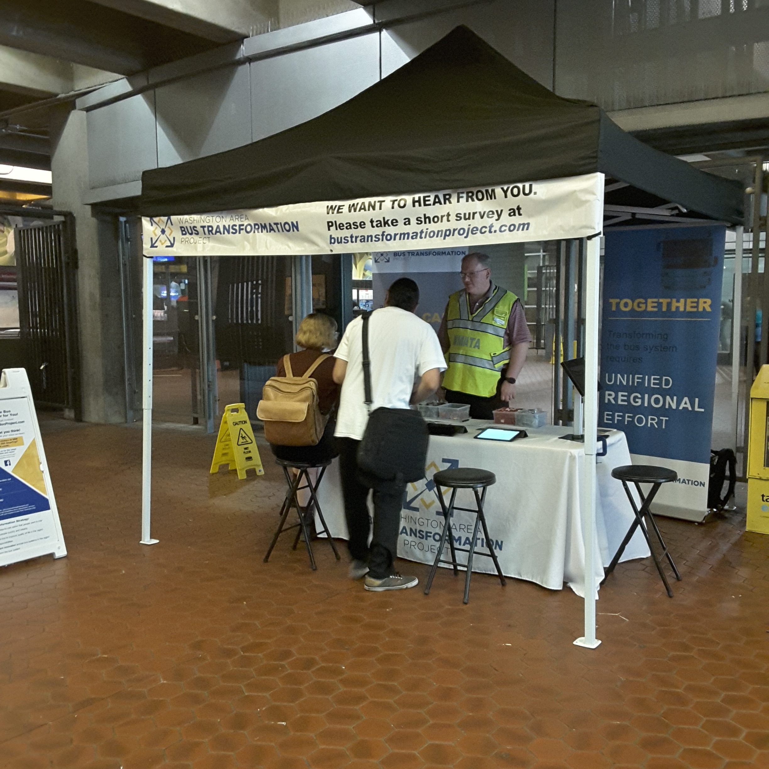 Event booth with people at the Rosslyn Metro Station