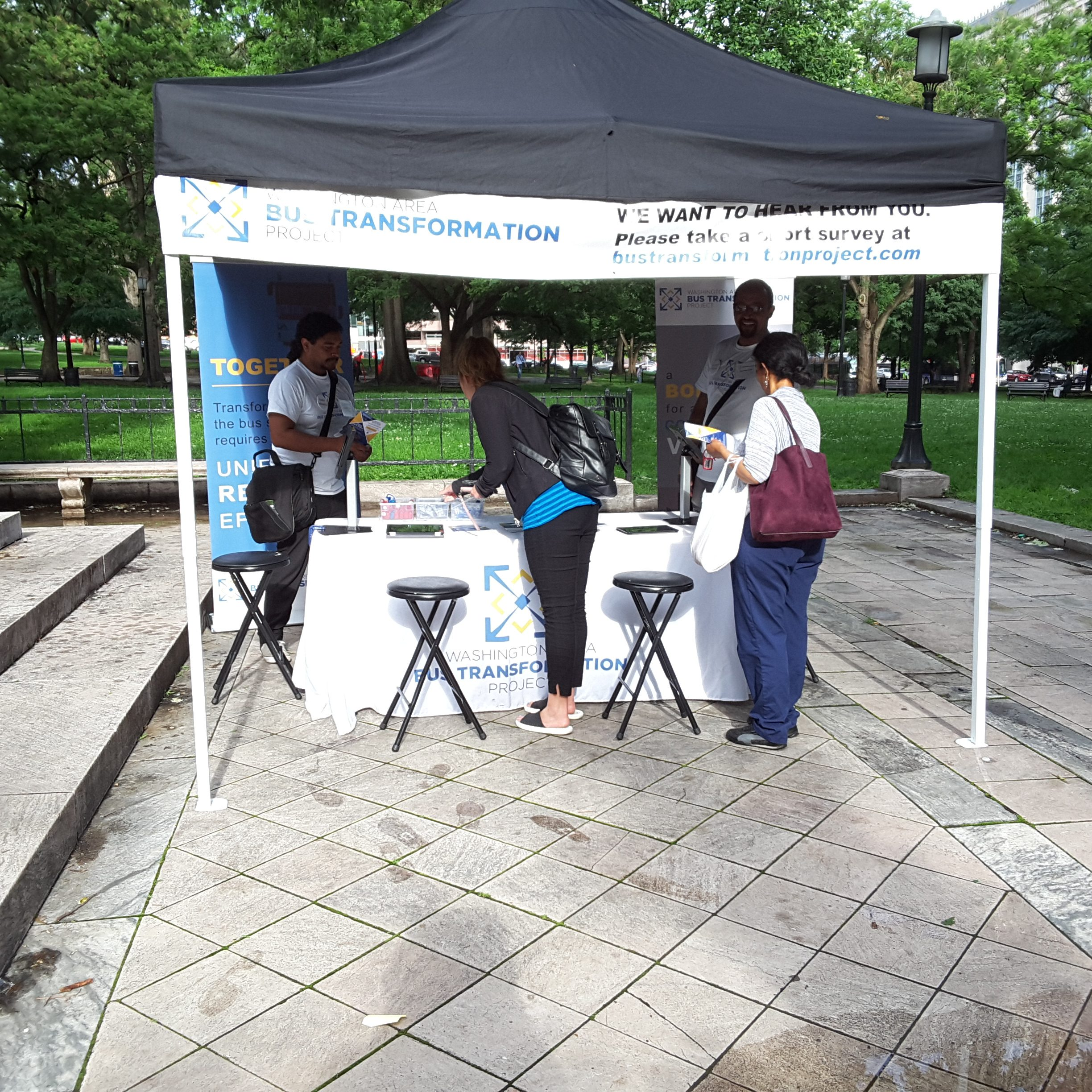 Event booth with people at the McPherson/Franklin Square Park