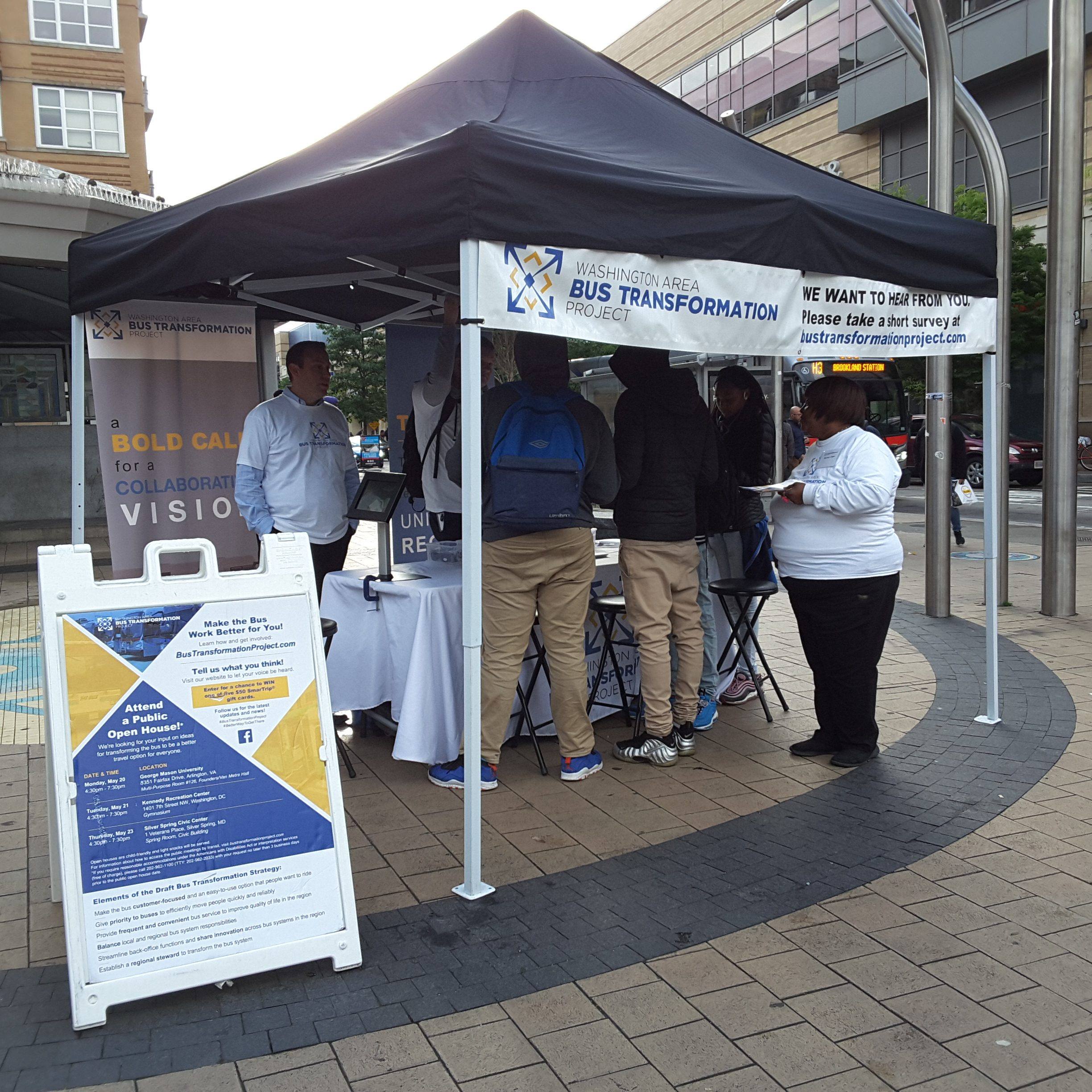 Event booth with people at the Columbia Heights Metro Station