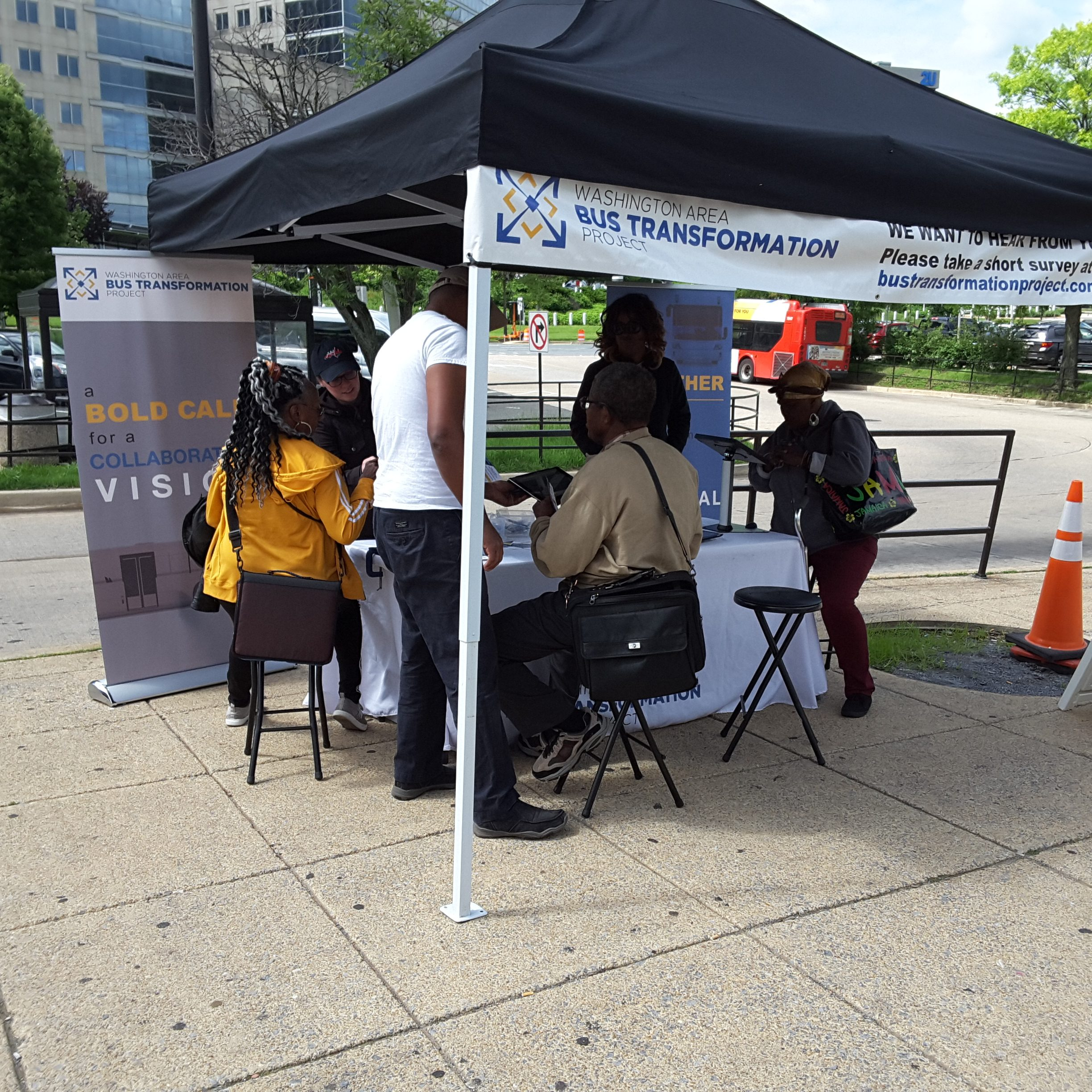 Event booth with people at the New Carrollton Metro Station