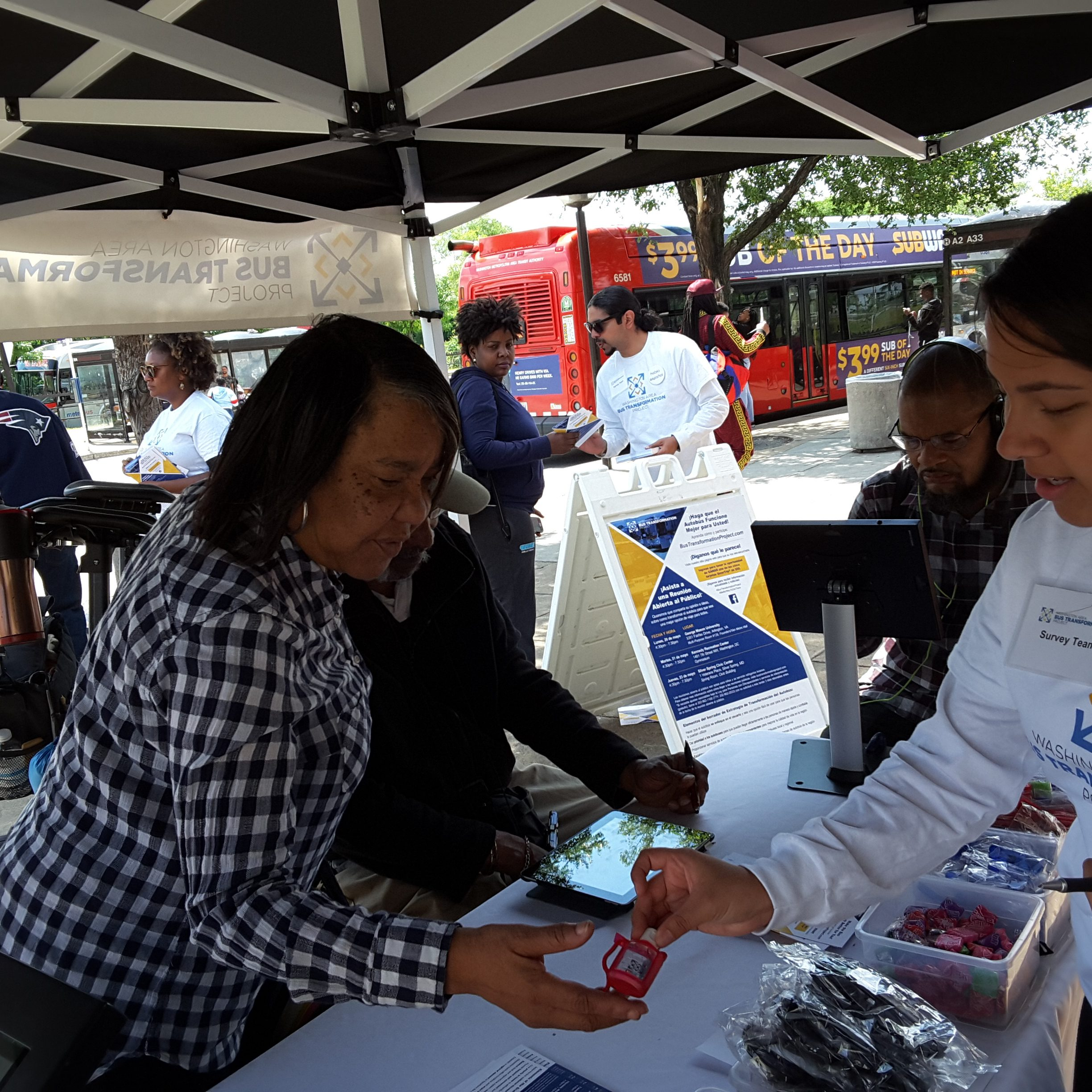 Event booth with people at the Anacostia Metro Station