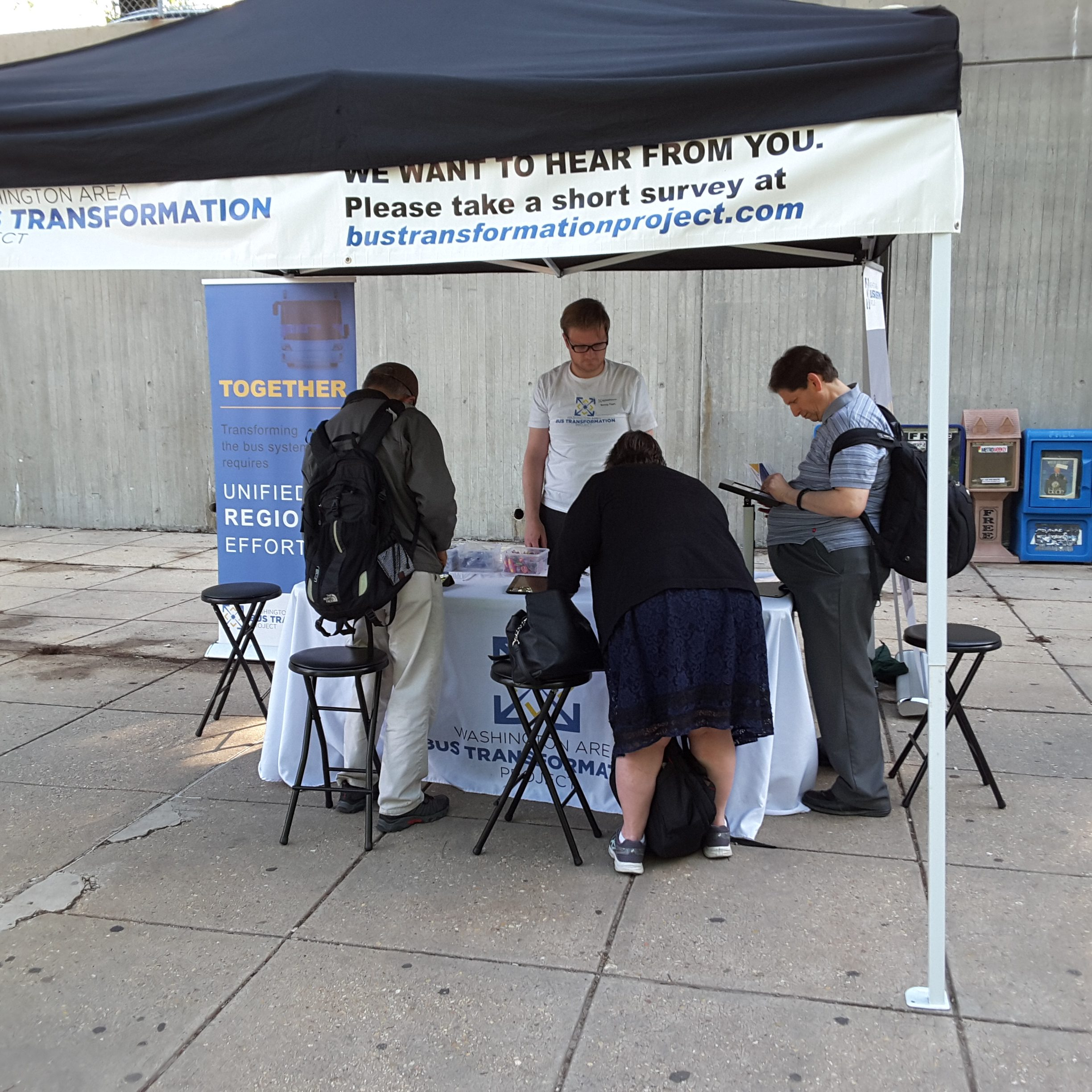 Event booth with people at the Shady Grove Metro Station