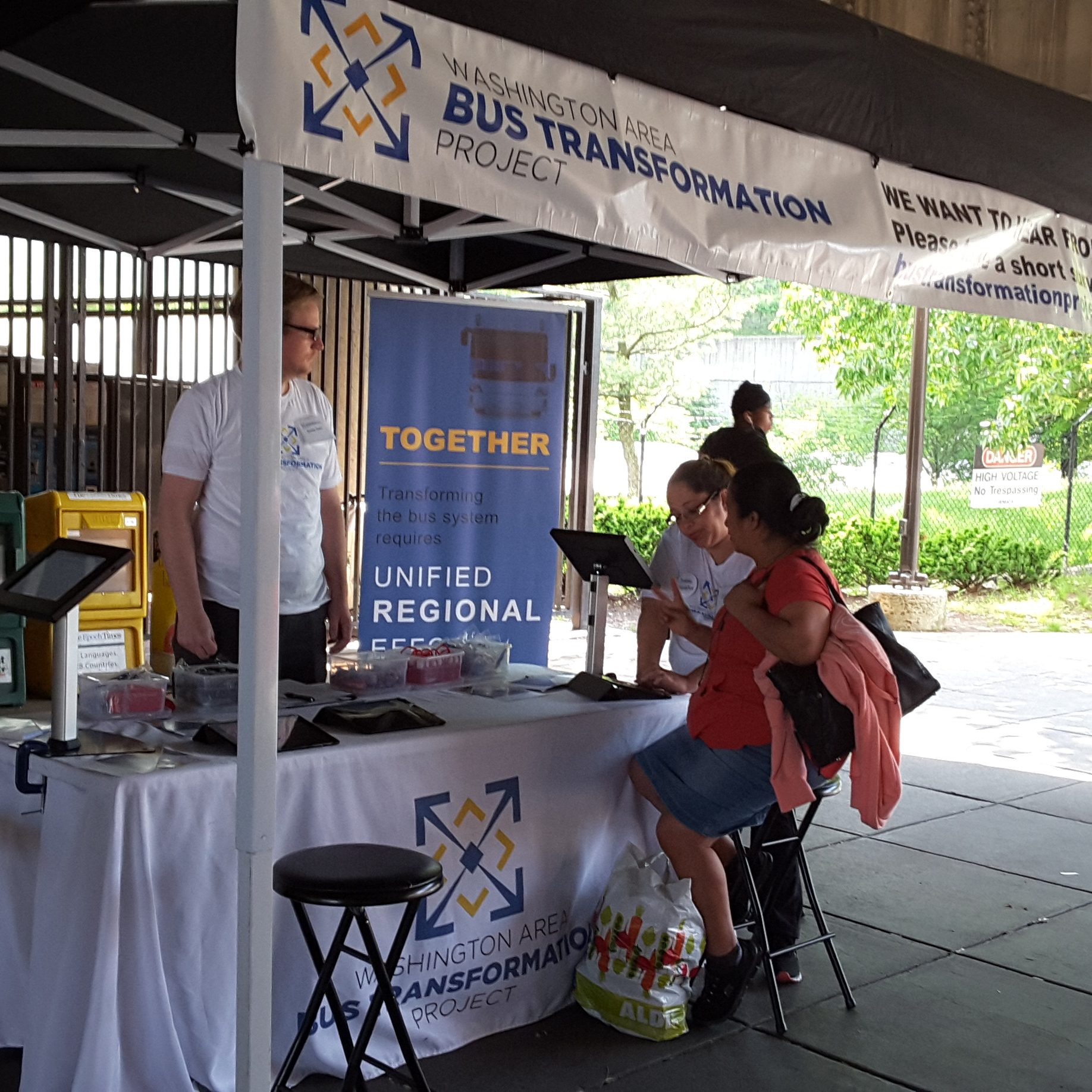 Event booth with people at the Fort Totten Metro Station