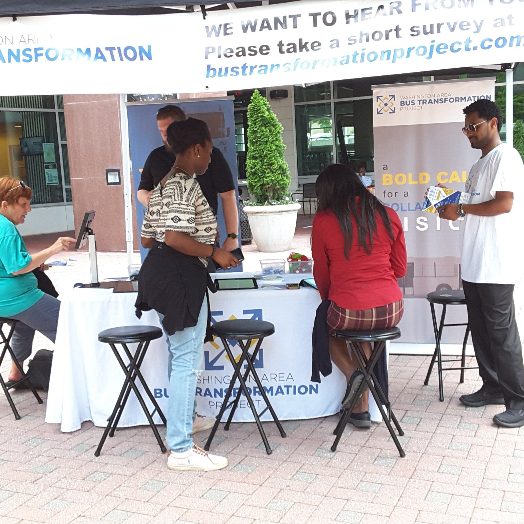 Event booth with people at the Village at Shirlington