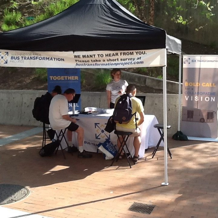 Event booth with people at the Silver Spring Paul S. Sarbanes Transit Center