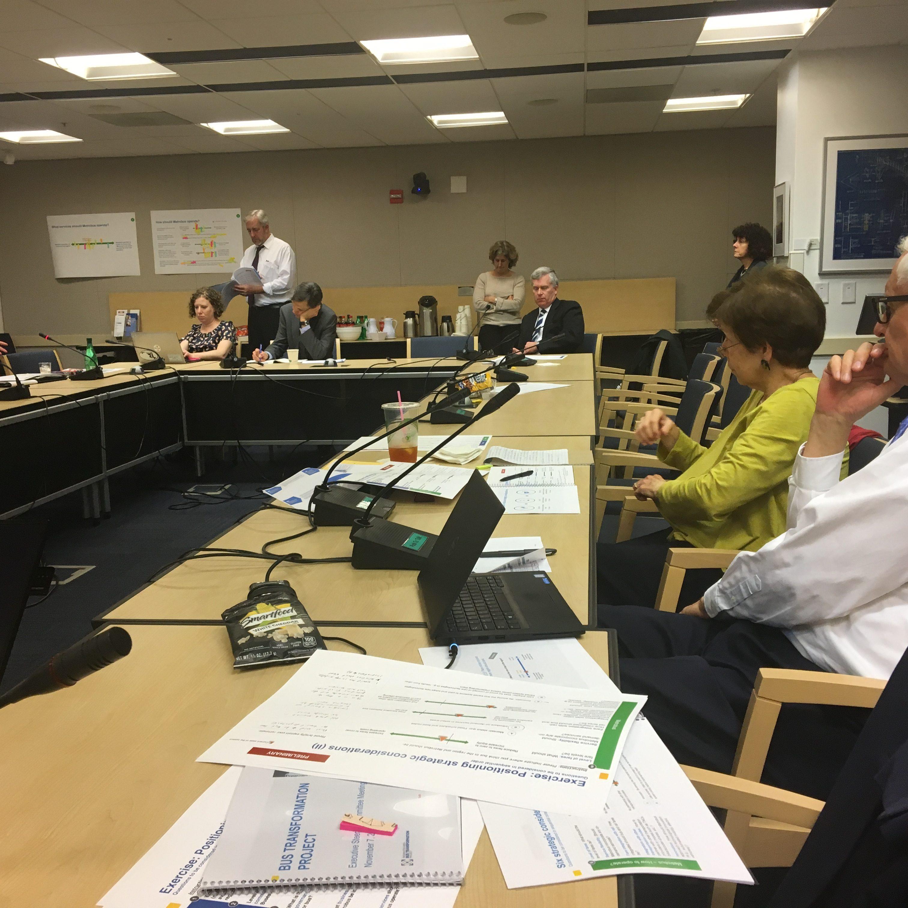 ESC meeting members sitting at desk
